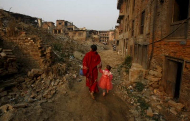 Women walk through a street in Nepal which has been affected by the earthquake