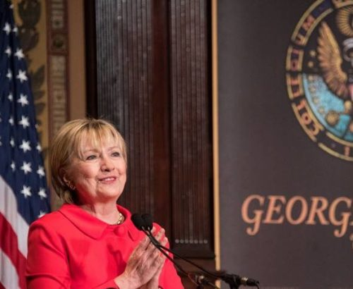 Hillary Clinton speaks from a podium at Georgetown