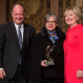 Hillary Clinton bestows an award upon Maria Paulina Riveros at Georgetown University