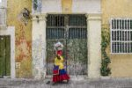 Colombian woman walks through street