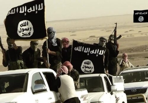 ISIS members drive in white cars and carry large ISIS flags