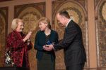 Alissa Rubin receives an award from Jack DeGioia and Melanne Verveer