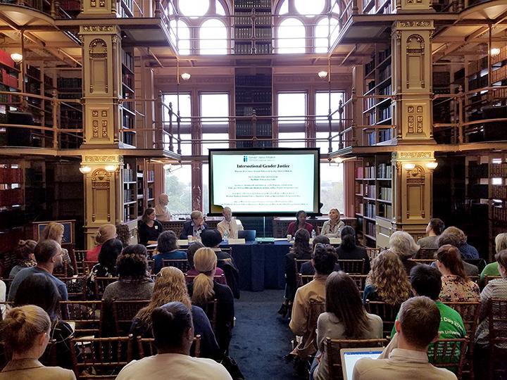 panelists at the Gender Justice Colloquium last year met in Riggs Library of Georgetown University.