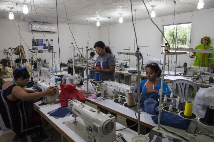 Women sewing in a factory in Pondores, Guajira