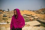 Veiled woman near desert