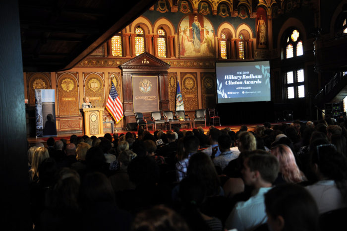 Gaston Hall at Georgetown University filled with students who listen to Hillary Clinton