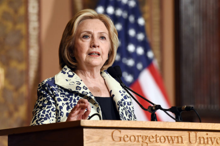 Hillary Clinton delivers speech from podium at Georgetown University