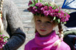 Young girl with pink flowers on her headband