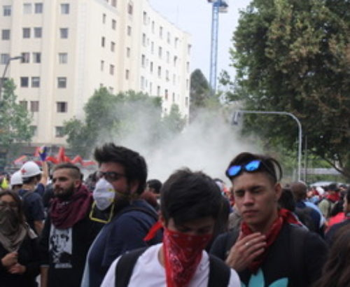 Protesters in Chile with face masks to guard against tear glass