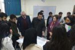 Dr. Nesreen Barwari discussing in a group.