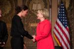 Hillary Clinton shakes hands with Elena Ambrosi