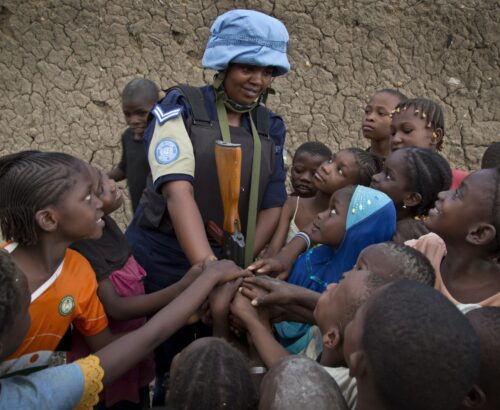 MINUSMA FPU Officers from Rwanda speak to the population as they patrol the streets of Gao, North of Mali.