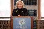 Ambassador Verveer speaks from a podium