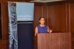 Roslyn Warren speaks from a podium