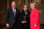 Hillary Clinton bestows an award upon Maria Paulina Riveros at Georgetown University