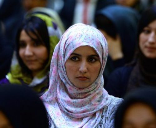 Afghan women listen to a speaker address a political gathering at a wedding hall in Kabul on September 26, 2013. Member of parliament Fawzia Kofi addressed approximately a hundred supporters in the hall ahead of the 2014 elections. AFP PHOTO/ SHAH Marai (Photo credit should read SHAH MARAI/AFP/Getty Images)