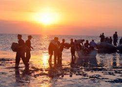 Sailors on ocean coastline near Haiti
