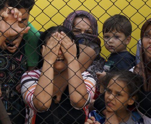 Women and children among Syrian refugees striking at the platform of Budapest Keleti railway station. Budapest, Hungary, Central Europe.