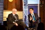 David Miliband and Joel Hellman on stage