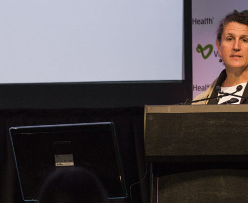 Jeni Klugman speaks from a podium
