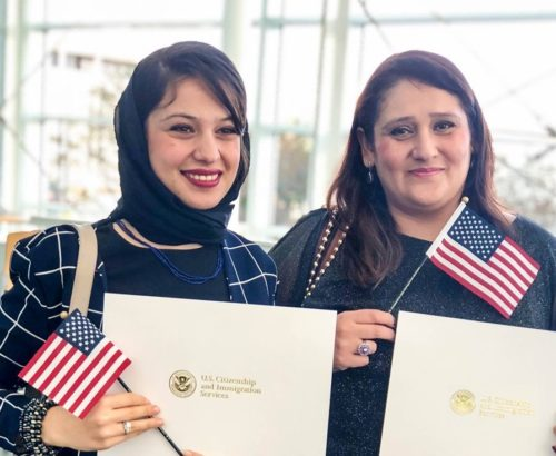 Refugee women in the US with American flags