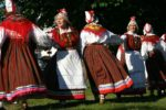 Women in traditional Estonian attire dancing