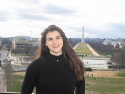 Grace Shevchenko poses with the Washington Monument in the background.