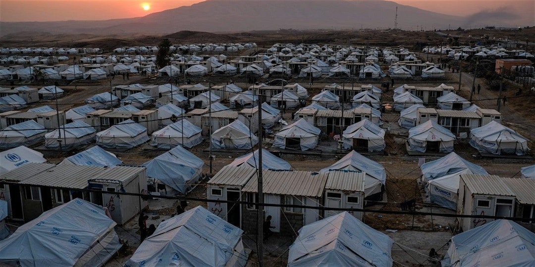 Numerous tents in a refugee camp