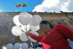 A woman holds white balloons during a demonstration to demand the immediate endorsement of the new peace agreement between the Colombian government and the FARC guerrilla outside the Colombian Congress in Bogota, on November 30, 2016. Colombia's Congress is debating the government's controversial revised peace deal to end a half-century conflict with leftist FARC rebels after last month voters surprisingly snubbed an earlier version of the accord in a referendum. Now the government hopes to implement a revised accord through its majority in the legislature. / AFP / GUILLERMO LEGARIA (Photo credit should read GUILLERMO LEGARIA/AFP/Getty Images)