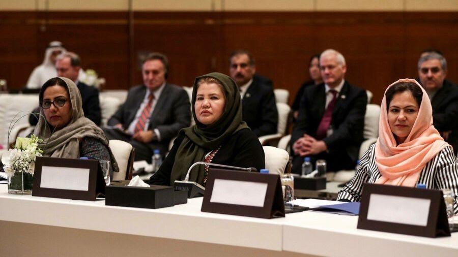 Photo of three women negotiators sitting on a panel
