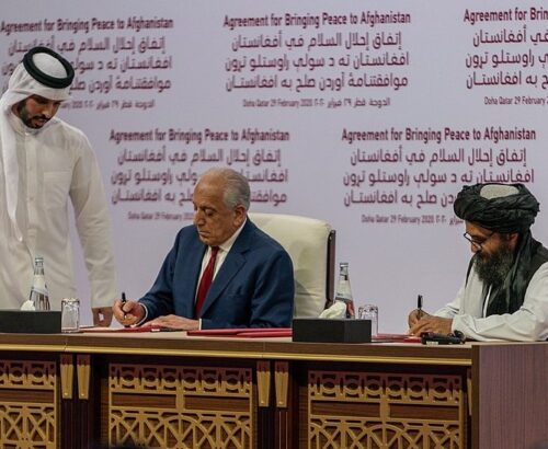 US representative Zalmay Khalilzad (left) and Taliban representative Abdul Ghani Baradar (right) sign the agreement in Doha, Qatar on February 29, 2020