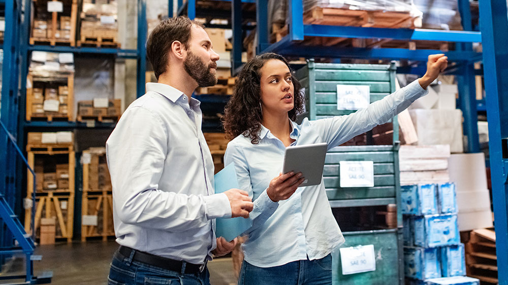 woman and man working together in a warehouse