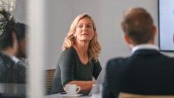 woman speaking in a boardroom
