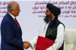 Photo taken at the US-Taliban peace talks in 2020 shows two men shaking hands.