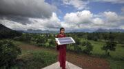 Women holds solar panel