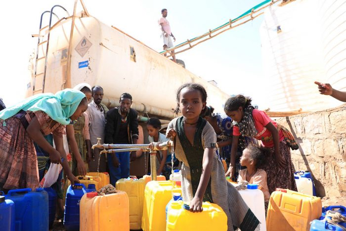 An image of internally displaced women and girls who left their homes as a result of the Tigray crisis shows the impact of the violence described on this page.