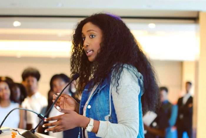 A photo of Bserat Ghebremicael, the person interviewed in this blog post, speaking to Black college students across the United States, discussing the role of Black consumers in technology