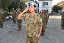 A decorative image taken from the report mentioned on this page shows a woman soldier in a peacekeeping uniform saluting.
