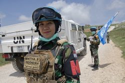 A decorative image taken from the report mentioned on this page shows a woman soldier in a helmet and peacekeeping uniform standing in front of a UNIFIL truck.