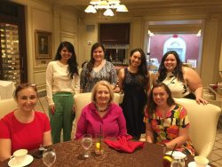Amb. Verveer poses with 5 Georgetown students