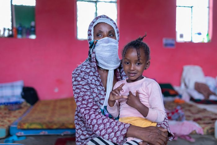 An image of a woman and young girl in an Internally Displaced Persons camp in Ethiopia taken by a UNICEF photographer shows the negative impacts of the crisis in Tigray on individuals who have been forced from their homes.