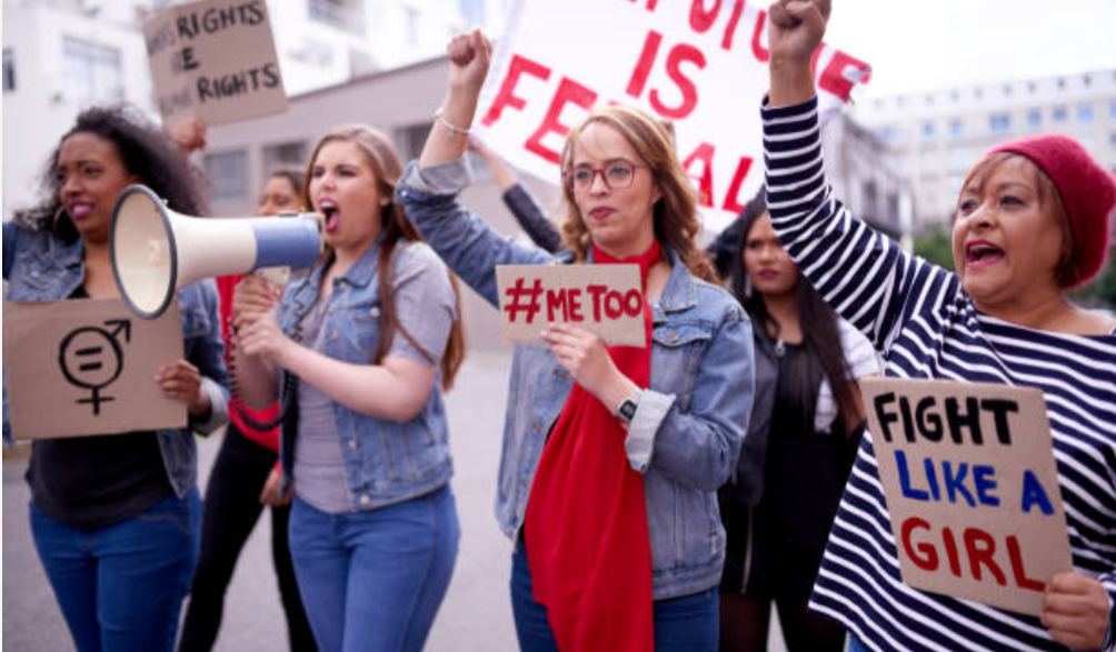A decorative image shows a group of women marching in the street with signs that read #MeToo, which is the theme of the event described on this page.