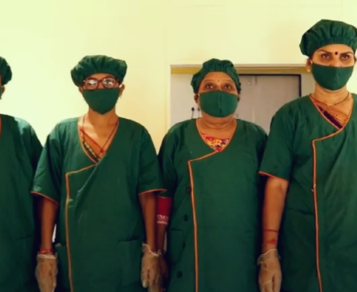 A decorative image shows members of the Self-Employed Women's Association, the organization featured in the article on this page, wearing personal protective equipment and face masks.