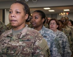 A photo shows US women soldiers in uniform standing in a line wearing military uniforms, illustrating the topic of the article found on this page.