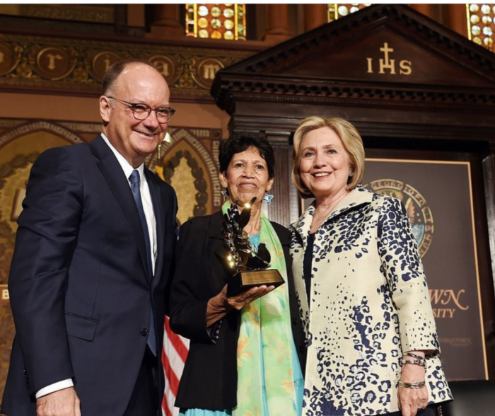 A photo of Virginia Velasquez, the person described in this post, receiving an award from Hillary Clinton at Georgetown in 2019.