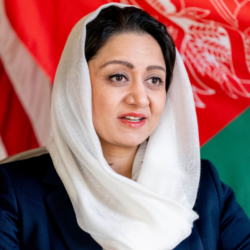 A decorative image of Roya Rahmani a distinguished fellow at the Institute, is included to accent her bio, below.
