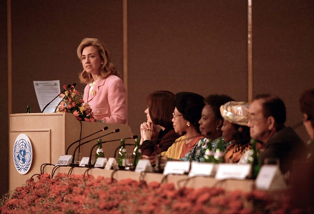 A decorative image of then-First Lady Hillary Rodham Clinton at the 1995 Beijing Conference is included to give the viewer a snapshot from the Conference, which is the subject of the event described on this page.